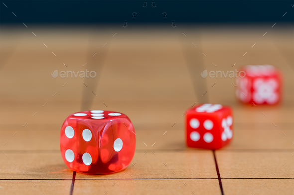 Red dices on wood board - Stock Photo - Images