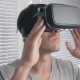 Young Man Using His VR Headset for Watching the 360 Video at Office Background - VideoHive Item for Sale