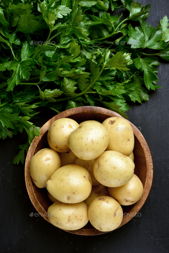 Raw potatoes and parsley, top view - Stock Photo - Images