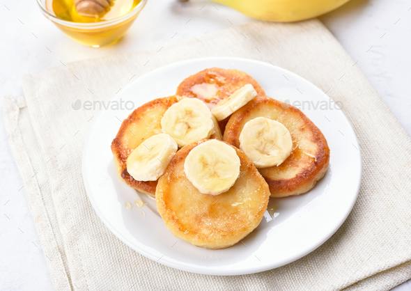 Pancakes with curd cheese and banana slices - Stock Photo - Images