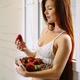Beautiful redhead with bowl of strawberries - PhotoDune Item for Sale