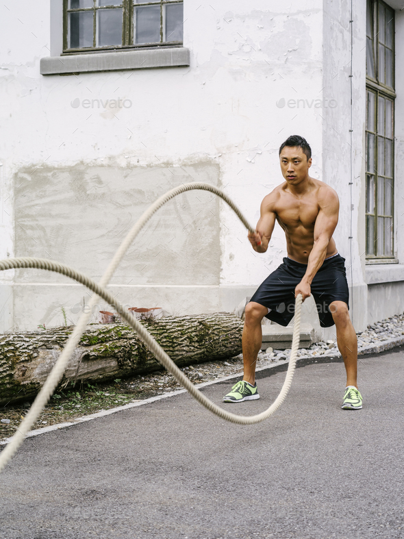 Workout outdoors with training ropes - Stock Photo - Images