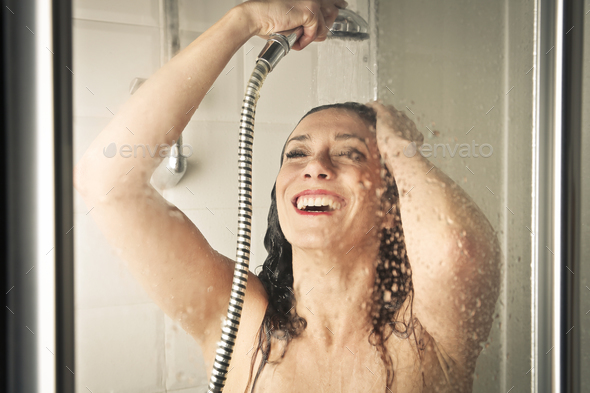 Woman in a shower - Stock Photo - Images