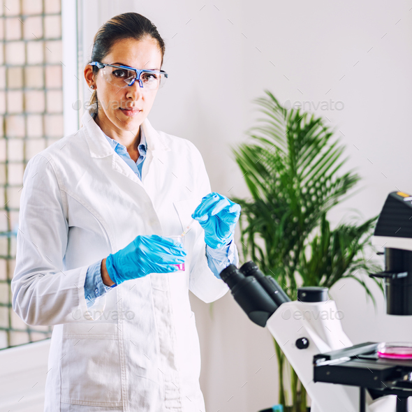 Lab technician with urine sample in laboratory - Stock Photo - Images
