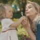 Mother and Little Daughter Playing Together, Blowing Bubbles. Mum and Child - VideoHive Item for Sale