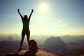 Successful hiker outstretched arms on sunrise mountain top - PhotoDune Item for Sale