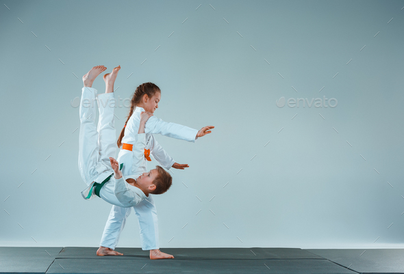 The boy fighting at Aikido training in martial arts school. Healthy lifestyle and sports concept - Stock Photo - Images