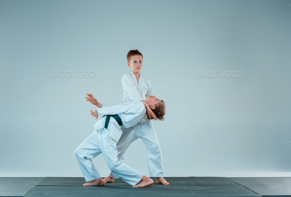 The two boys fighting at Aikido training  - Stock Photo - Images