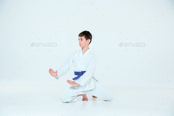 The boy posing at Aikido training in martial arts school. Healthy lifestyle and sports concept - Stock Photo - Images