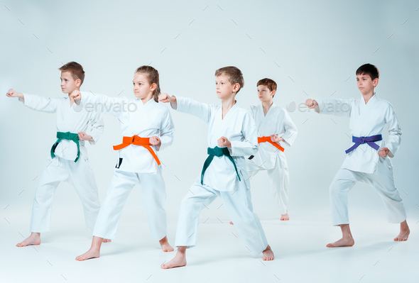 The group of boys and girl fighting at Aikido training - Stock Photo - Images