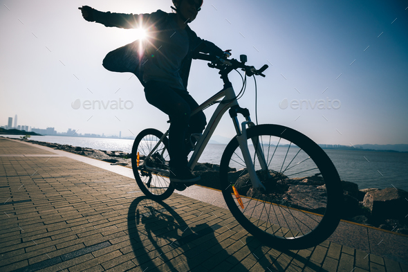Cycling in the sunrise  - Stock Photo - Images