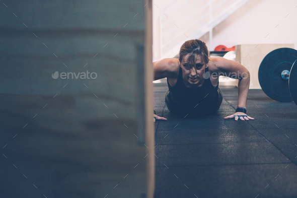 Girl doing burpees - Stock Photo - Images