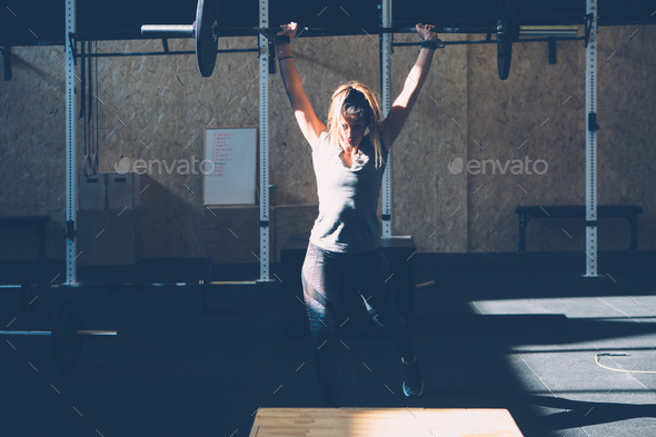Girl doing jerks with barbell - Stock Photo - Images