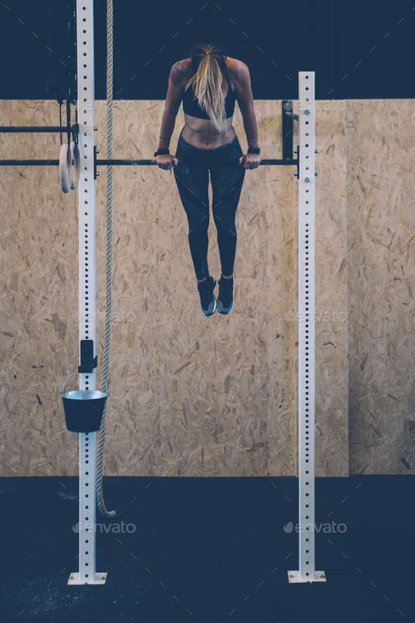 Girl doing muscle up exercise - Stock Photo - Images