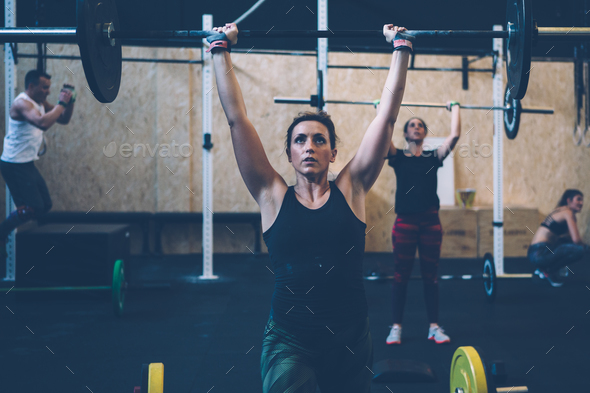 Girls doing jerk with barbell - Stock Photo - Images