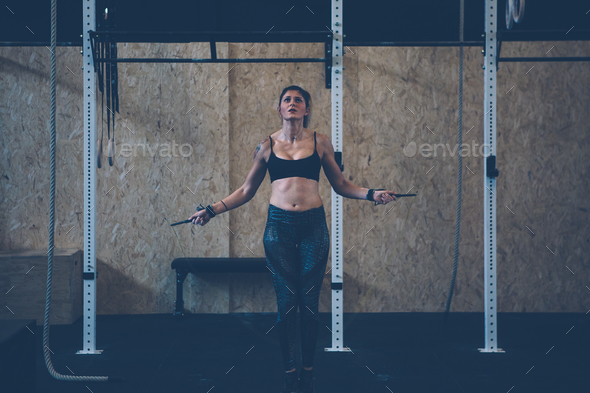 Girl doing single unders - Stock Photo - Images