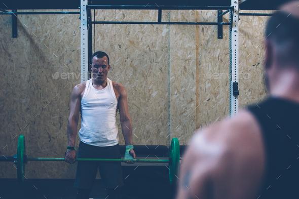 Man doing deadlift exercise - Stock Photo - Images
