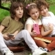 Students Sit on the Grass During a School Break and Take a Selfie. Two Boys and a Girl, School - VideoHive Item for Sale