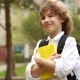 Portrait of a Schoolboy with a Book in His Hands. The Boy Looks Thoughtfully Into the Distance and - VideoHive Item for Sale