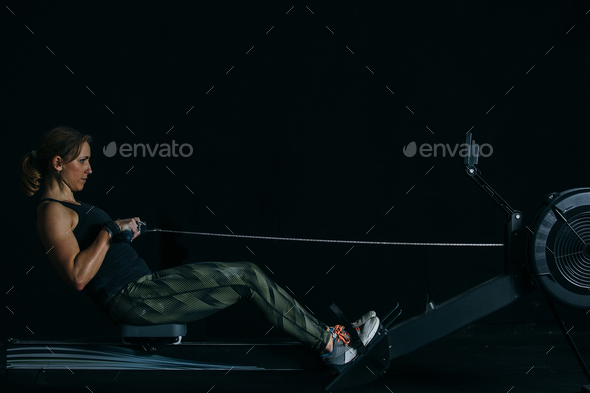 Girl does rowing exercise - Stock Photo - Images