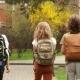 Schoolchildren Return From School. Back To School. Three Children, Two Boys and a Girl, Classmates - VideoHive Item for Sale