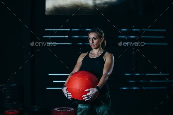 Female athlete and wall ball - Stock Photo - Images