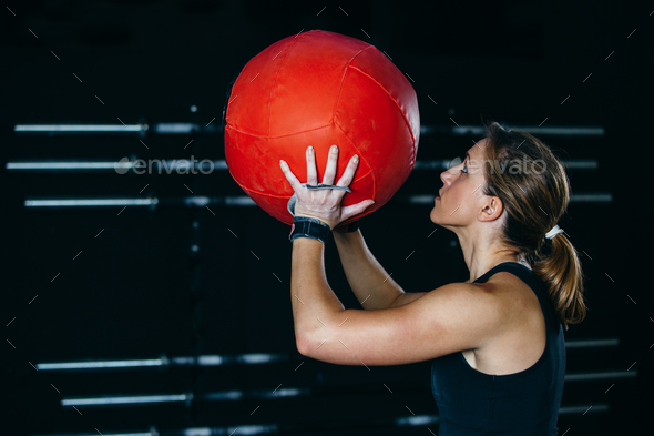 Girl doing wall ball exercise - Stock Photo - Images
