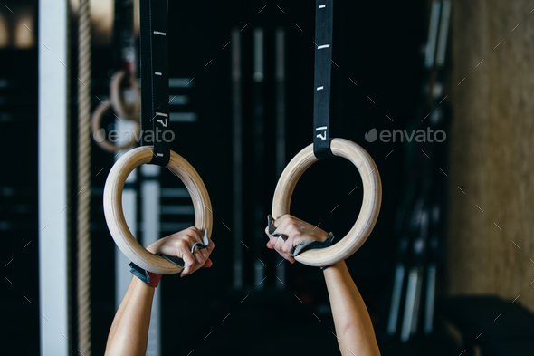 Girl doing deep rings exercise - Stock Photo - Images