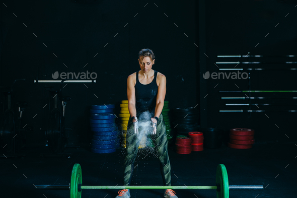 Magnesia powder and barbell. - Stock Photo - Images