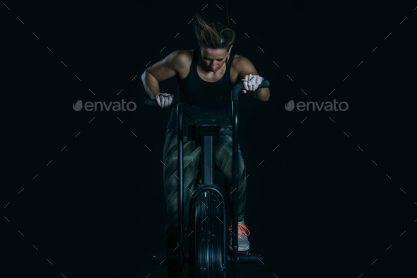 Young woman does calorie assault exercise - Stock Photo - Images