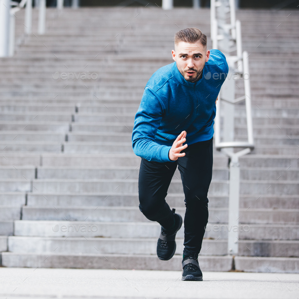Handsome sportsman running in athletic clothes - Stock Photo - Images