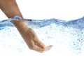 Woman's hand taking the water. - PhotoDune Item for Sale