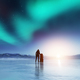 Adventurous man standing with a backpack, looking at aurora. - PhotoDune Item for Sale