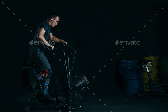 Man doing calorie assault exercise - Stock Photo - Images