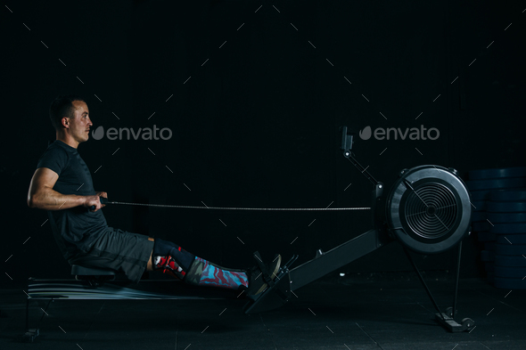 Man does rowing exercise - Stock Photo - Images
