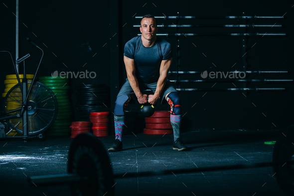 Man does kettlebell swing exercise - Stock Photo - Images