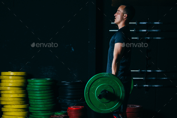 Man doing deadlift exercise - Stock Photo - Images
