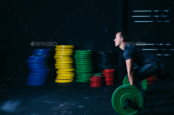 Man ready for a barbell snatch - Stock Photo - Images