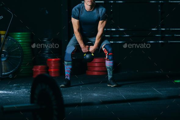 Sporty man doing kettlebell swing exercise - Stock Photo - Images