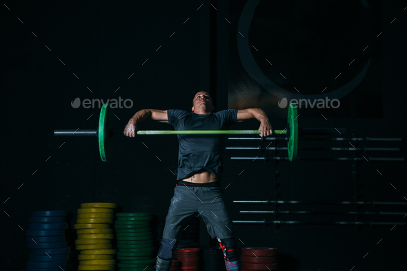 Man doing power snatch exercise - Stock Photo - Images