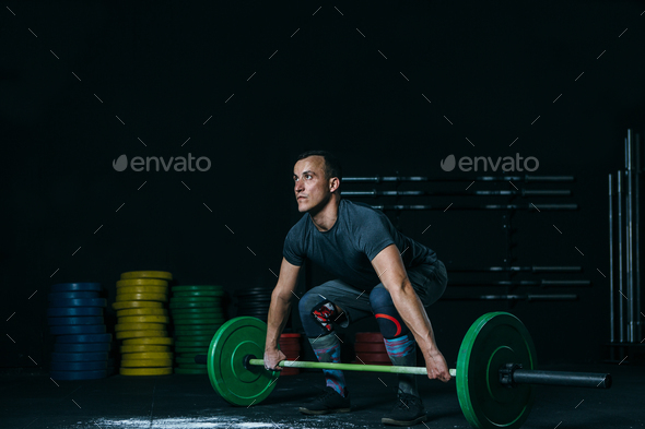 Young man ready for a barbell snatch - Stock Photo - Images