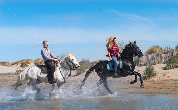riders on the beach - Stock Photo - Images