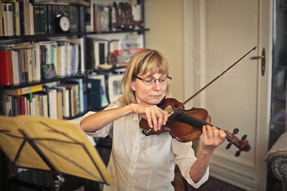 Woman playing the violin - Stock Photo - Images