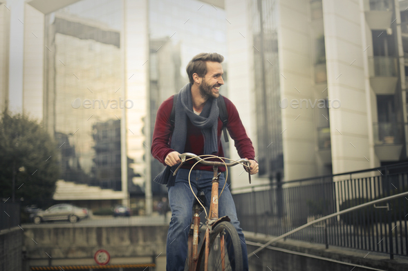 Man cycling in an urban context - Stock Photo - Images