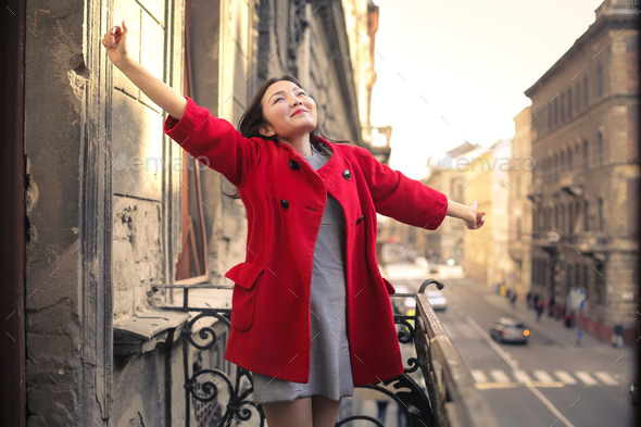 Happy woman on a balcony - Stock Photo - Images