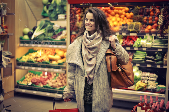 Woman in a spermarket - Stock Photo - Images