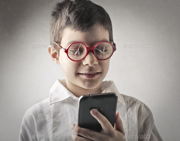 Child with broken glasses  - Stock Photo - Images