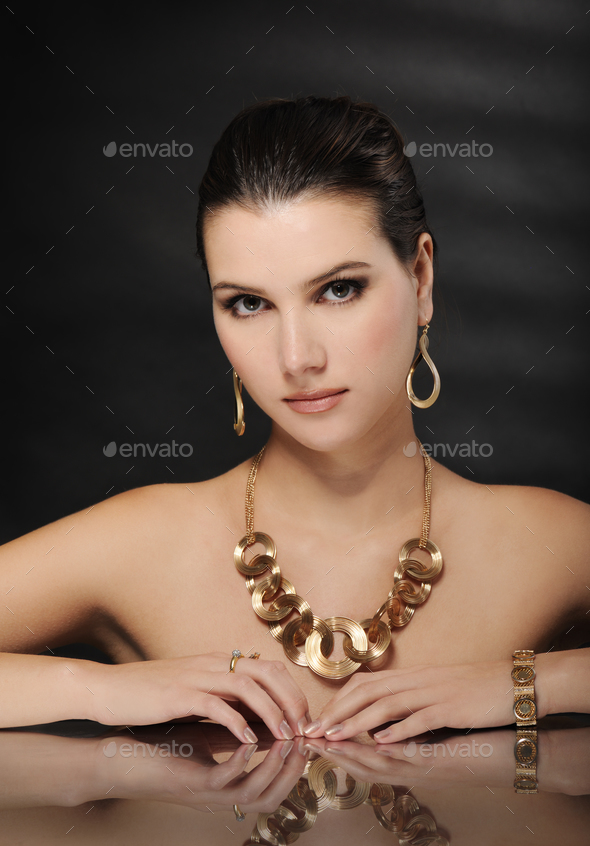 beautiful woman in golden jewelry - Stock Photo - Images