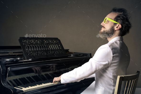 Man playing a piano - Stock Photo - Images