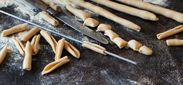Making whole wheat flour pasta Maccheroni al ferro - Stock Photo - Images